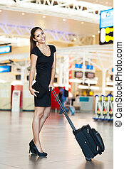 attractive businesswoman at airport
