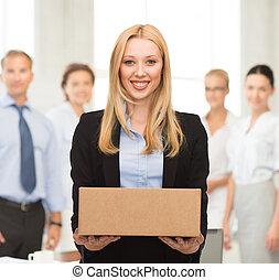 businesswoman delivering cardboard box - attractive...