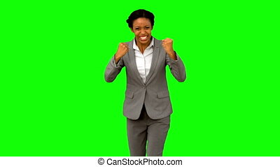 Attractive businesswoman gesturing on green screen in slow...