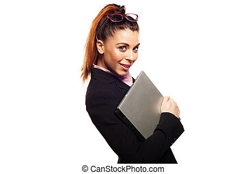Attractive businesswoman holding a laptop