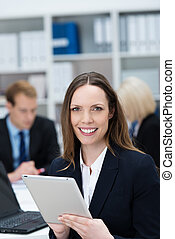 Attractive businesswoman holding a tablet-pc