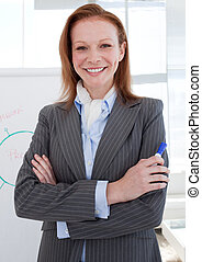 Attractive businesswoman in front of a white board