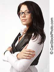 Attractive businesswoman in glasses with her arms crossed