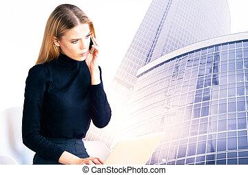 Attractive businesswoman in modern city