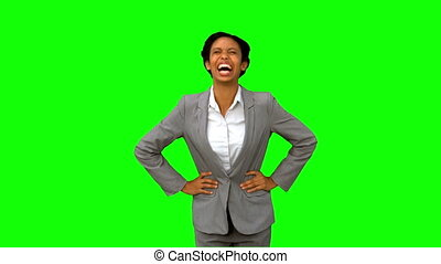 Attractive businesswoman laughing on green screen in slow...