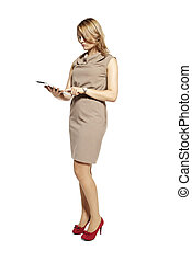 Attractive businesswoman looking at digital tablet