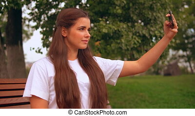 attractive businesswoman making photo