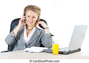 Attractive businesswoman phoning