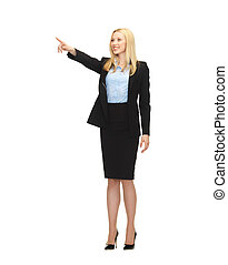 attractive businesswoman pointing at something