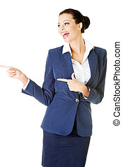 Attractive businesswoman pointing.