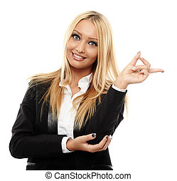 Attractive businesswoman pointing to the copyspace