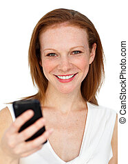 Attractive businesswoman sending a text
