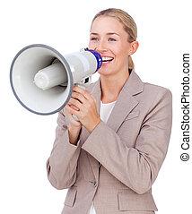 Attractive businesswoman shouting through a megaphone...