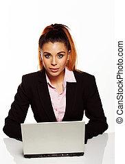 Attractive businesswoman sitting at her desk