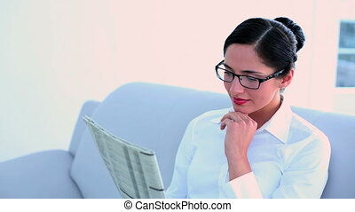Attractive businesswoman sitting on couch
