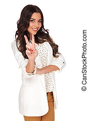 attractive businesswoman smiling and making peace sign