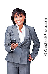 Attractive businesswoman smiling at the camera while sending a text against a white background