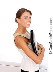 Attractive businesswoman standing on white background