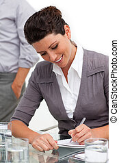 Attractive businesswoman taking notes