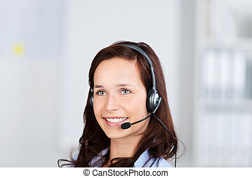 Attractive businesswoman wearing a headset