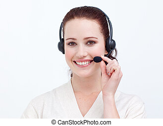 Attractive businesswoman with a headset on