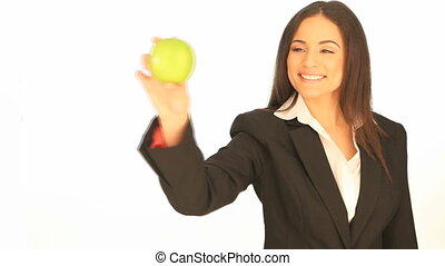 Attractive businesswoman with apple
