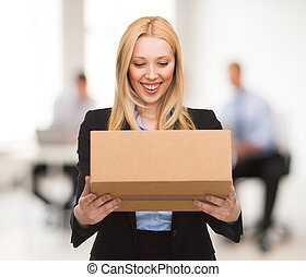 businesswoman with cardboard box - attractive businesswoman...