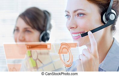 Attractive call center employee looking at futuristic...
