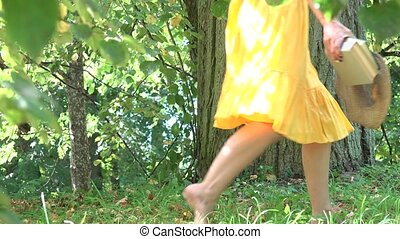 Attractive carefree girl sit under tree and read books in park on sunny summer day.