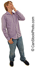 Attractive casual teen boy laughing over white background.