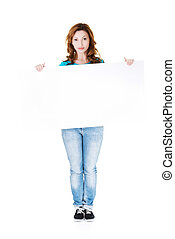 Attractive casual woman holding copy space.