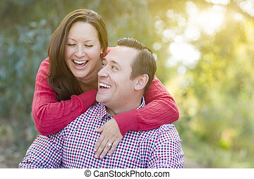 Attractive Caucasian Couple Laughing Outdoors