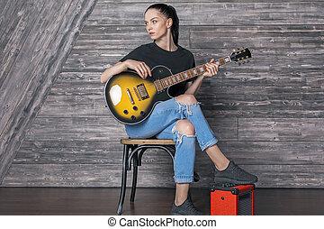 Attractive caucasian girl with guitar - Attractive caucasian...