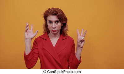 Attractive caucasian young woman showing eight fingers, ...