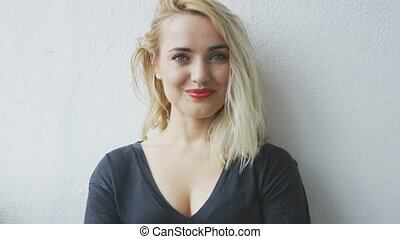 Attractive cheerful young blond woman - Happily smiling...
