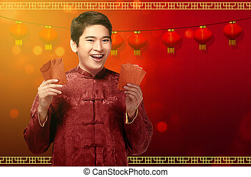 Attractive chinese man in traditional clothes showing angpao on his hands