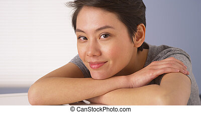 Attractive Chinese woman looking at camera