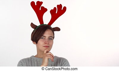 Attractive Christmas girl looking thoughtfully to the camera, isolated