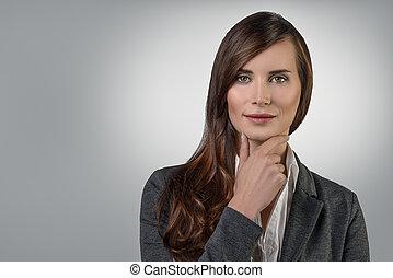 Attractive confident smiling businesswoman