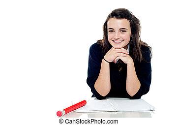 Attractive confident young schoolgirl posing