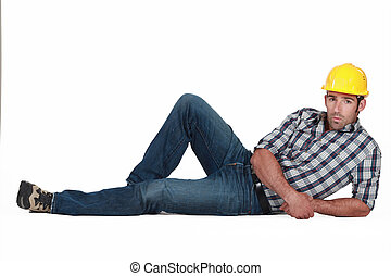 Attractive construction worker lying down
