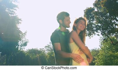 Attractive couple dancing outdoors