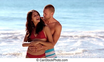 Attractive couple embracing together