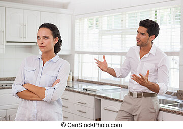 Attractive couple fighting with eac