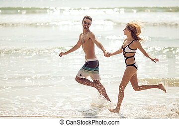 Attractive couple have fun on beach