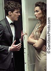Attractive young couple having a serious argument