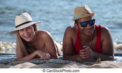 Attractive couple having fun on the beach