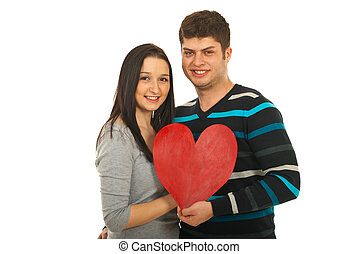 Attractive couple holding heart