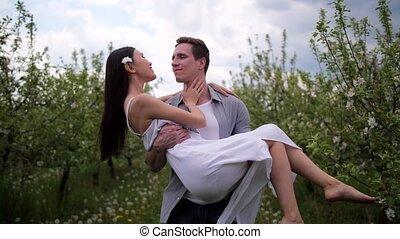 Attractive couple in love dating in apple garden