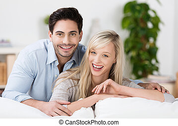 Attractive couple laughing at home